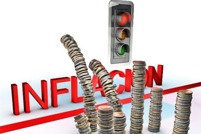 Fotomontaje con monedas saltando la barrera de la inflación