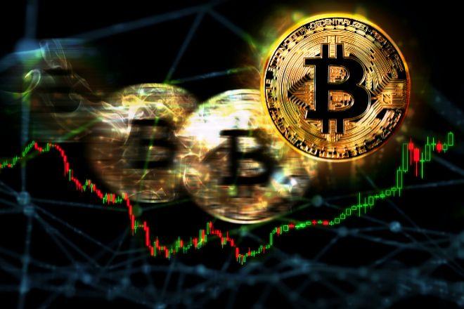 Monedas de bitcoin entre gráficos bursátiles