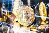 Moneda de bitcoin con gráficos bursátiles