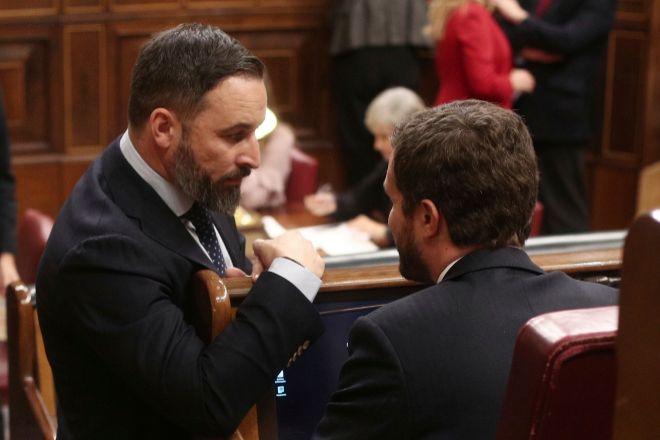 El líder de Vox, Santiago Abascal. y el líder del PP, Pablo Casado.