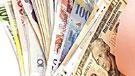 Imagen de un montón de billetes de diferentes países