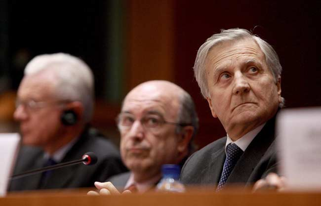 El presidente del Banco Central Europeo, Jean Claude Trichet, el presidente del Parlamento Europeo, el alemán Hans Gert Poettering y el comisario europeo de Asuntos Económicos, el español Joaquín Almunia