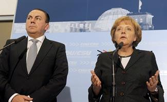 Weber y Merkel en un acto conjunto celebrado en septiembre de 2008 | Foto Efe